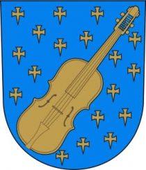 Kuvassa Kaustisen vaakuna kultainen viulu sinisellä taustalla.